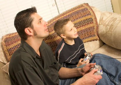 father-and-son-playing-video-games.jpg